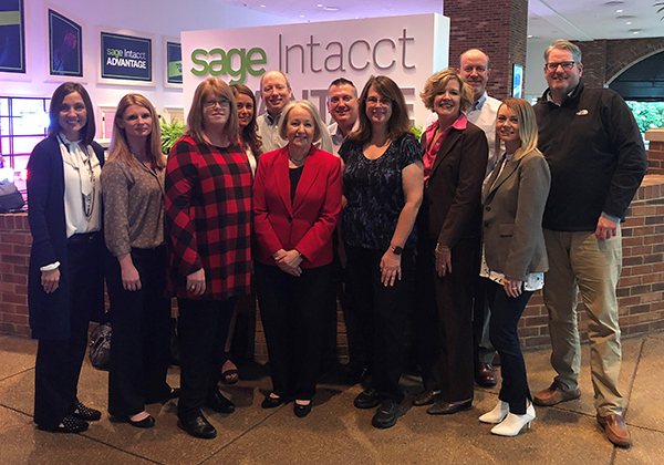 Barbara Harris and team from Pathway Lending celebrate with LBMC Technology Solutions after receiving the 2018 Sage Intact Customer Success Award.